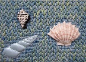 Raised shells on canvaswork